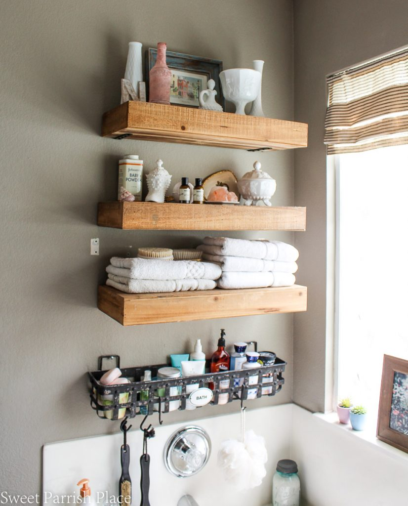 Farmhouse Bathroom Makeover Progress with rustic floating shelves