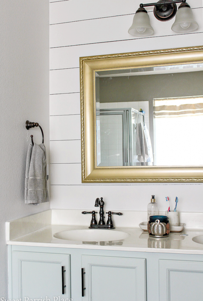 Sharpie Shiplap on Textured Walls with seal salt cabinets and gold mirror