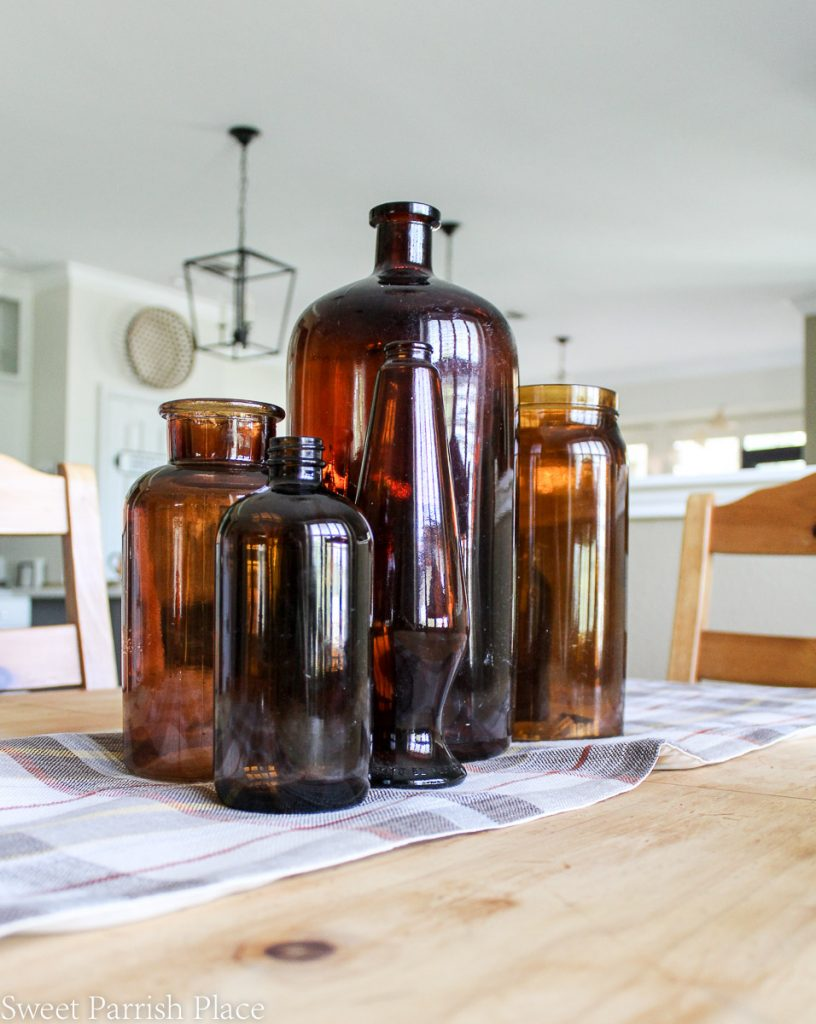 amber bottles on rustic wood table