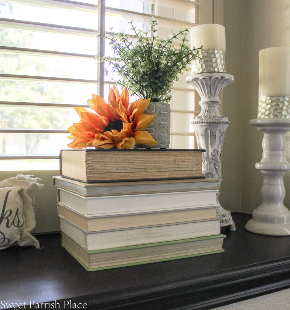 sunflower on stack of books