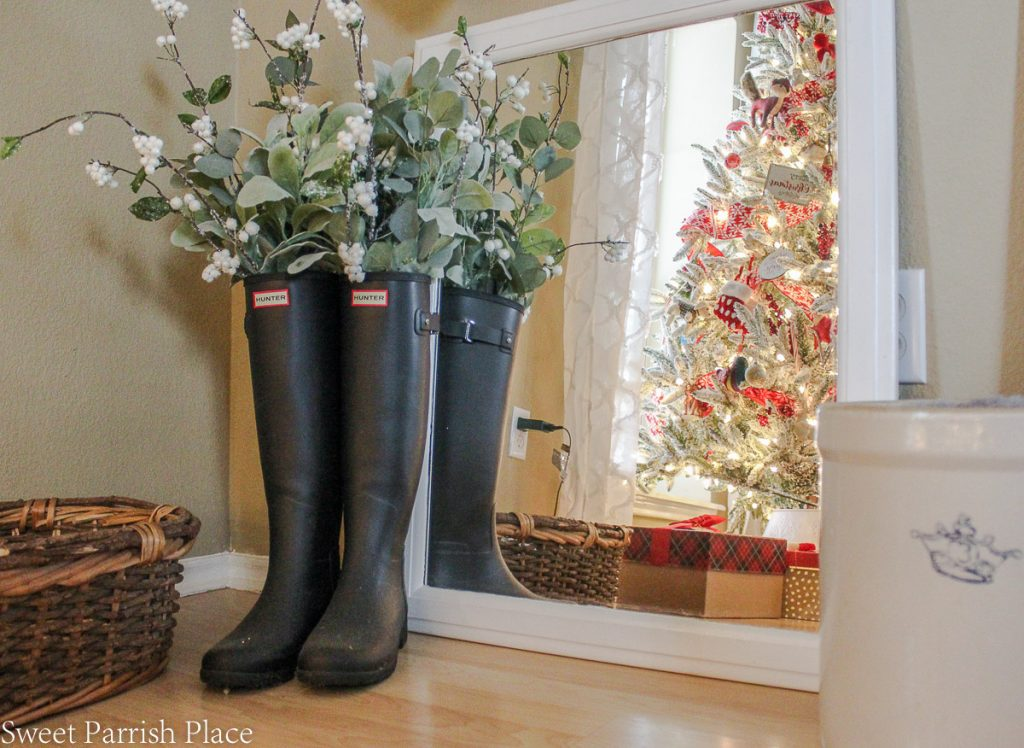 Hunter boots with greenery and white berries