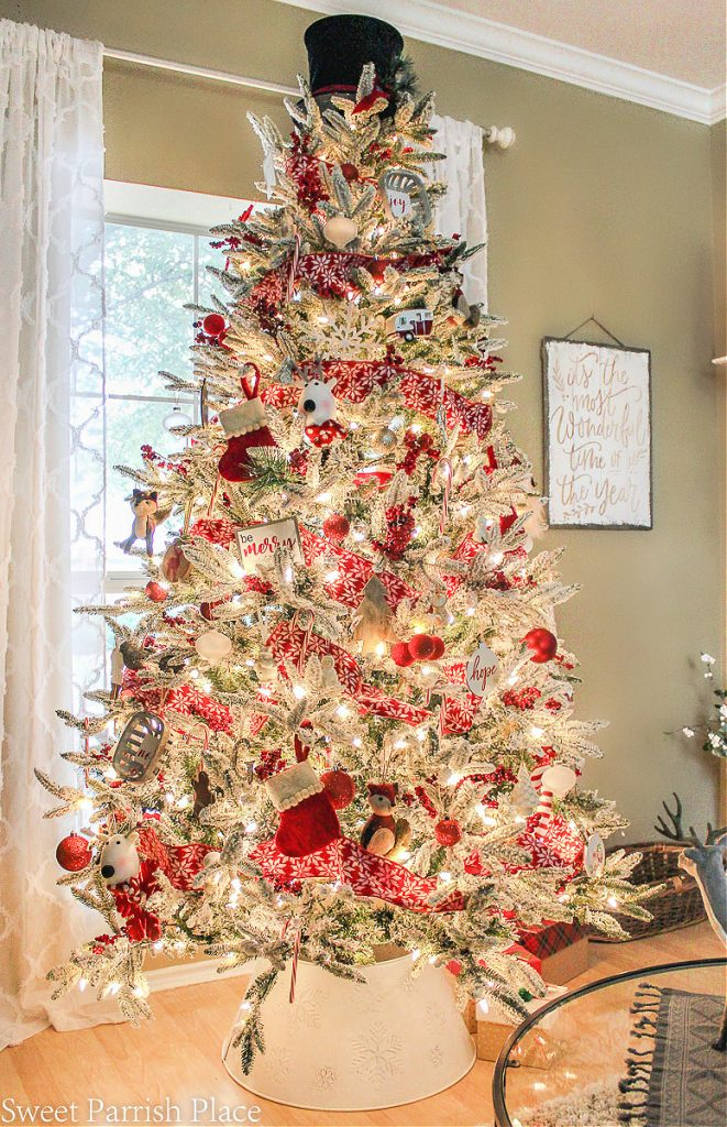flocked Christmas tree with red and white decorations