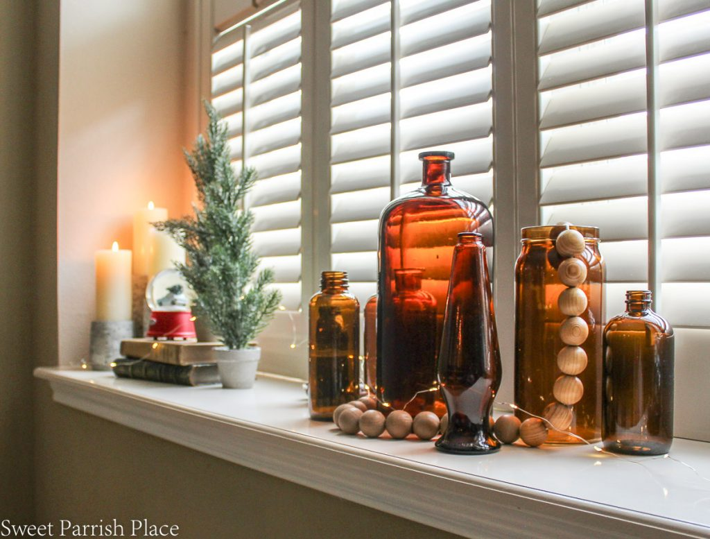 window sill with amber bottle collection casual and cozy Christmas Tour