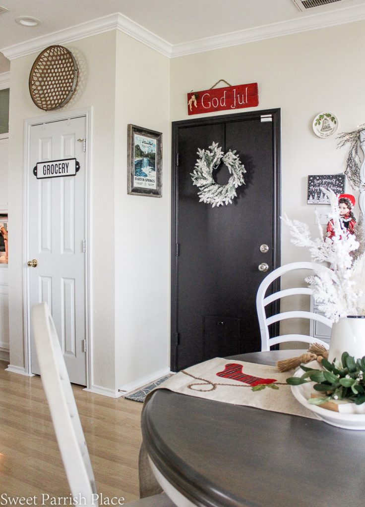 black door with flocked wreath and God Jul sign