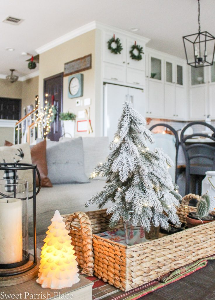 cozy and casual Christmas tour flocked tree on coffee table