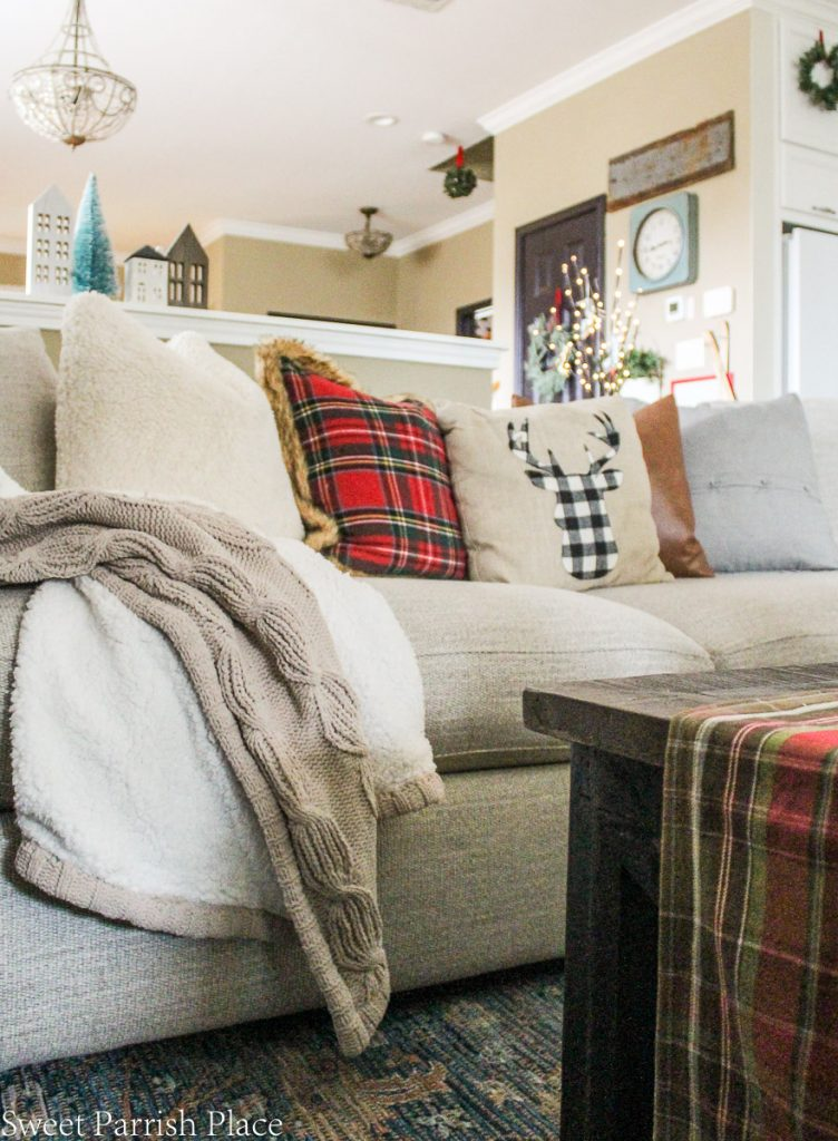 cozy throw on sofa with Christmas pillows